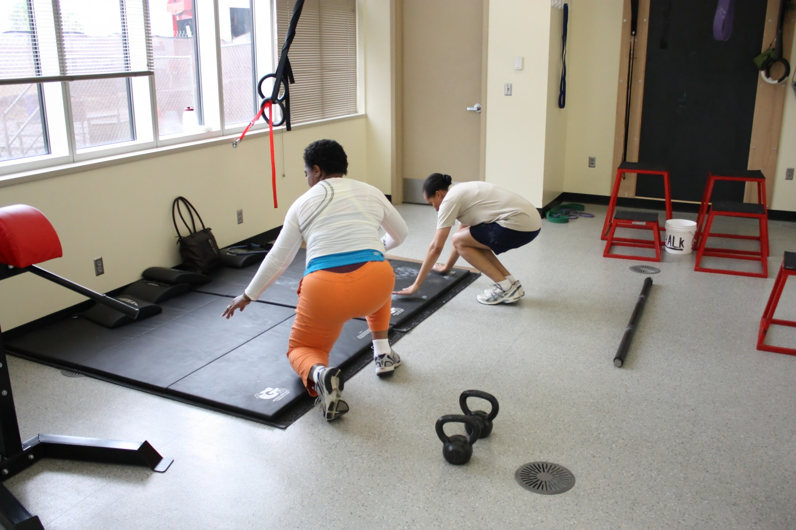 Brenda and Lili gettin' down on some burpees